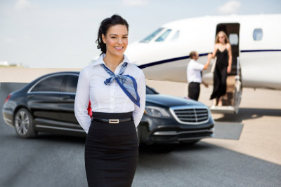 airhostess standing against Llimousine